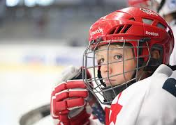 Youth Hockey Player Watching from Bench