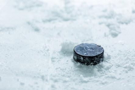 Hockey Puck on Snowy Ice